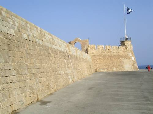 The greek flag at the Firkas Bastion at the entrance to the harbour of Chania