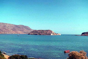 The islet of Spinalonga and the Venetian fort in front of the village of Plaka