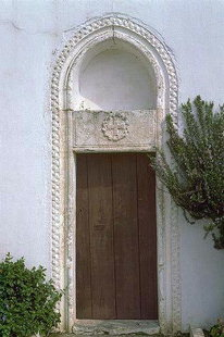 The portal of Agii Fotini and Agios Spiridon Church, Kastelli, Pediada