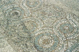 Mosaic remains of the earlier church in front of the Panagia, Thronos