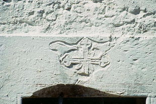 A decoration above the door of Agii Apostoli Church, Petrohori