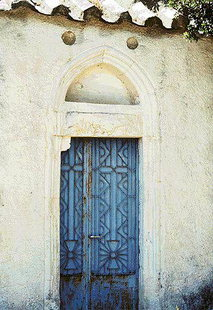 The portal and rosettes of the Panagia Church in Hordaki
