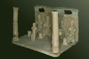A clay model of worshipers found in the Kamilari tomb