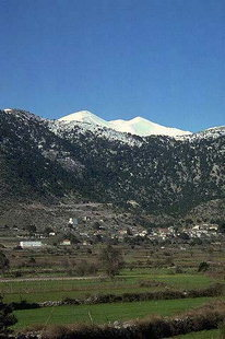 Amoudari village nestled below Mount Kastro