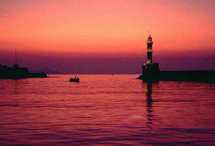 The lighthouse and the harbour at sunset, Chania