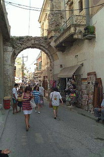 The Guora Gate and the busy shopping area of Rethimnon