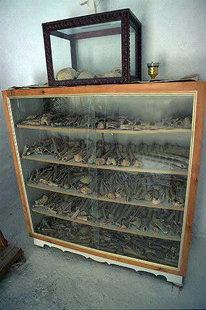 Bones of the murdered men displayed in the church, Ziros