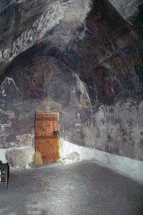 The frescoed interior of the Panagia Mesohoritisa in Males