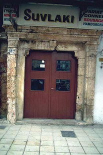 Venetian portal with inscription on Odos Halidon, Chania