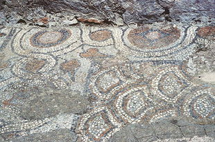 Mosaic remains of the earlier church in front of the Panagia Church in Thronos
