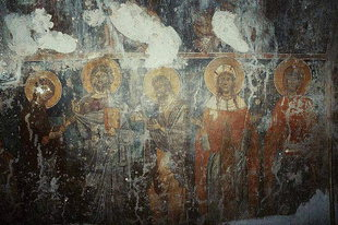 A frescoed wall in Agia Paraskevi Church, Voutas
