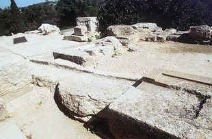 Stone Basin feeding into the water channel of the East Bastion, Knossos
